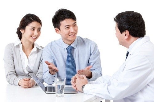 Happy young couple asking for doctor's advices